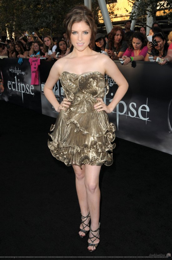Well, it looks like Anna Kendrick's trying for girlie and youthful in this frilly Marchesa cocktail dress, and that's a big improvement for the actress who usually takes style cues from ladies who lunch. Just wish it were red or something more fun—the gold feels so subdued we can't get behind it.