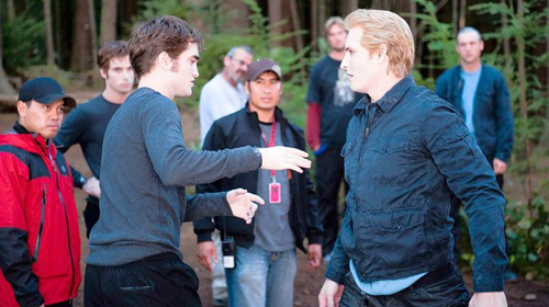 Robert Pattinson, left, and Peter Facinelli size each other up as Eusebio watches.