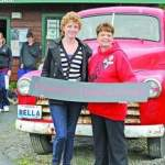 Brooke, left, poses with Forks Chamber of Commerce director Marcia Bingham in front of Bella's pickup at the Forks visitors center while on the Twilight Tour. Brooke, of Orange County, Calif., is visiting Forks through Make-A-Wish -- Photo by Lonnie Archibald/Peninsula Daily News