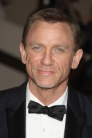 Daniel Craig Age: 42 Single? The James Bond star has officially been 'in a relationship' with producer girlfriend Satsuki Mitchell for quite some time. The pair are even rumoured to have secretly married back in the spring. See Him Next: In the exciting new 3D film The Adventures of Tintin: Secret of the Unicorn, which is set to hit the big screen early 2011.