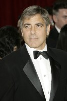 George Clooney Age: 49 Single? Clooney's current beau is the stunning Italian model Elisabetta Canalis. Jealous, us? See Him Next: He just gets better with age, doesn't he? See a sophisticated Clooney doing what he does best – playing a master assassin in thriller flick The American.