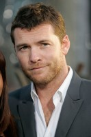 Sam Worthington Age: 33 Single? Sadly no. The Avatar star is currently cosying up to Australian stylist Natalie Mark. See Him Next: In romantic drama Last Night, which sees the British-born actor appearing alongside Eva Mendes and Keira Knightley, lucky boy!