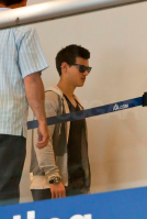 Taylor Lautner was spotted going through the security at LAX on June 27th
