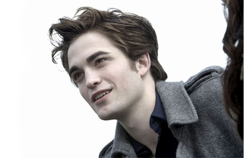 First of all, the demands of compressing a 500-page book into a two-hour movie mean that most of the boring scenes of Edward brooding about stuff have been cut. In fact, for the entire middle third of the movie, Edward seems happy most of the time, which Robert Pattinson frankly plays a lot better than he does the dark, serious looks.