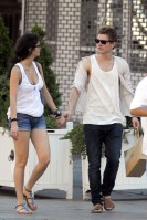 Xavier Samuel, who plays the role of Riley in Eclipse, takes a stroll around Soho with his unidentified girlfriend. Samuel carried a Ralph Lauren shopping bag while looking casual. (July 4, 2010)